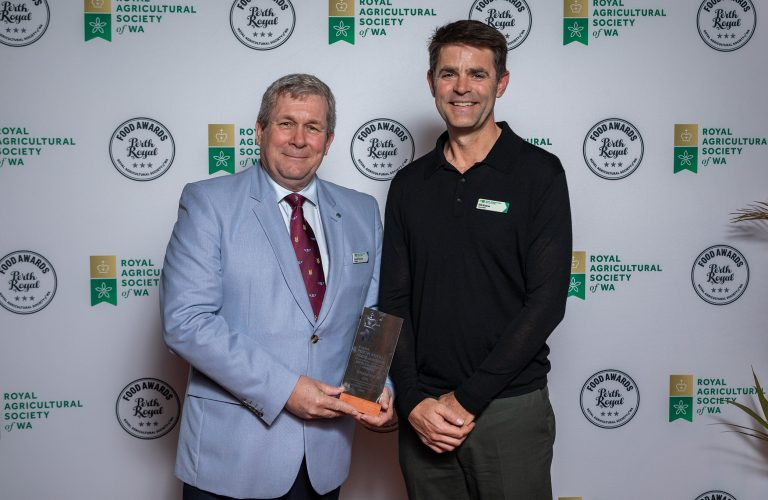 RASWA President David Thomas presenting the Award For Champion Gin to Small Batch Distilling for Red Hen Gin (Accepted by RASWA Councillor Bill Keane on behalf of Small Batch Distilling)