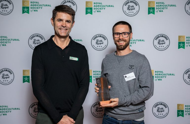 Bill Keane (RASWA Councillor) presenting the award for Champion Whiskey to Mark Affleck from Whipper Snapper Distillery.