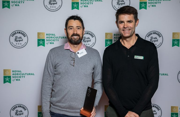 Bill Keane (RASWA Councillor) presenting the award for Champion Brandy to Craig Humphries from St Agnes Distillery